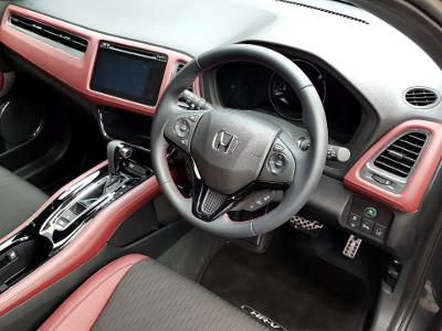 The Honda HR-V Sport features a sporty two-tone red and black interior