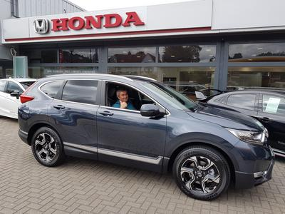 Mr Kobal gives a thumbs-up from the seat of his new Honda CR-V