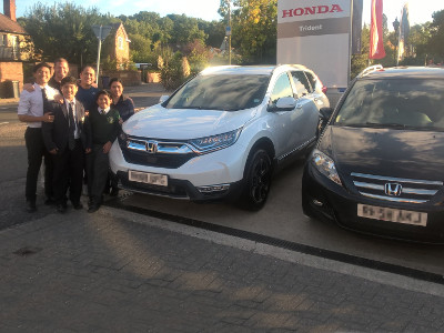 The Aure family collect their new 7-seater Honda CR-V