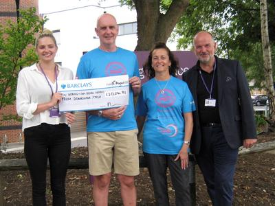 Downslink Challenge hands cheque for £10,294.83 to Woking & Sam Beare Hospices