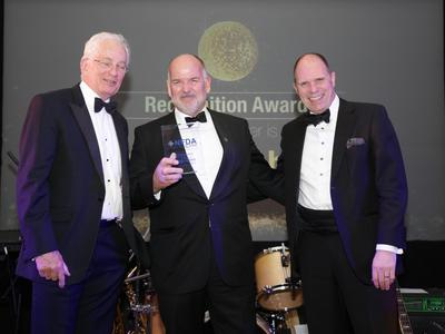 Richard Roberts, Managing Director of Trident Honda, collects his NFDA Recognition Award