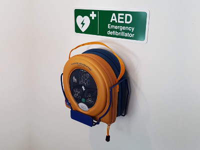 Our new defibrillator in its place on our reception wall