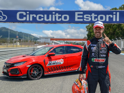 A victorious Tiago Monteiro stands beside his winning Type R