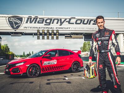 Esteban Guerrieri stands beside his Civic Type R