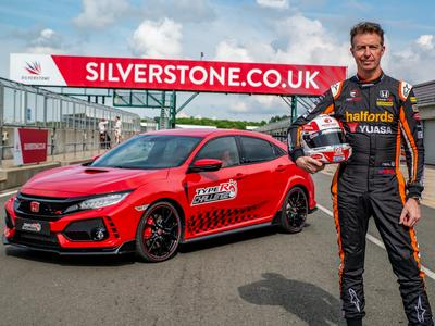 A victorious Matt Neal stands beside his winning Type R