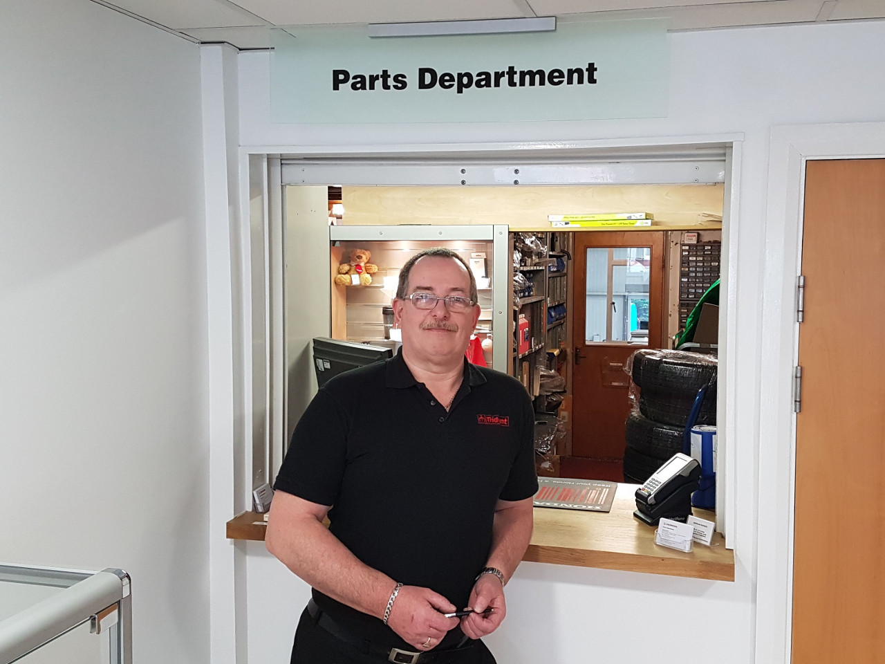 Martin Williams standing outside the Parts retail counter