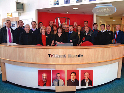 Paul Barnett with his colleagues from Trident Honda Weybridge
